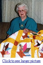 Picture of Inez Michael and the quilt